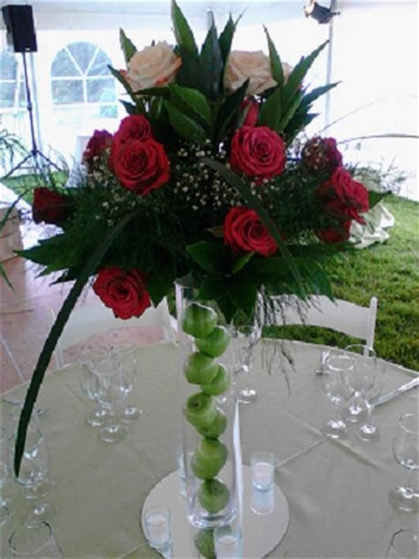 Fresh flower arrangements on a tall vase ? Raji Creations