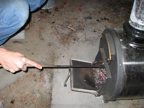 Chofu, stoking fire