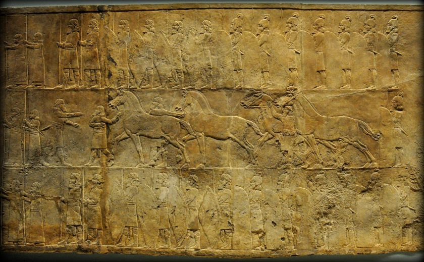 Assyrian Lion. In this alabaster bas-relief, grooms appear to lead horses towards a screened enclosure within which a royal chariot is being prepared for the hunt. Men are struggling to push one of the horses into position while another horse is having his harness tightened. From Room C of the North Palace, Nineveh (modern-day Kouyunjik, Mosul Governorate), Mesopotamia, Iraq. Circa 645-535 BCE. The British Museum, London. Photo©Osama S.M. Amin.