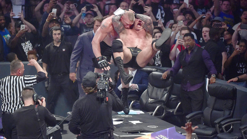 ... But Orton rallies with an RKO onto the Raw desk.