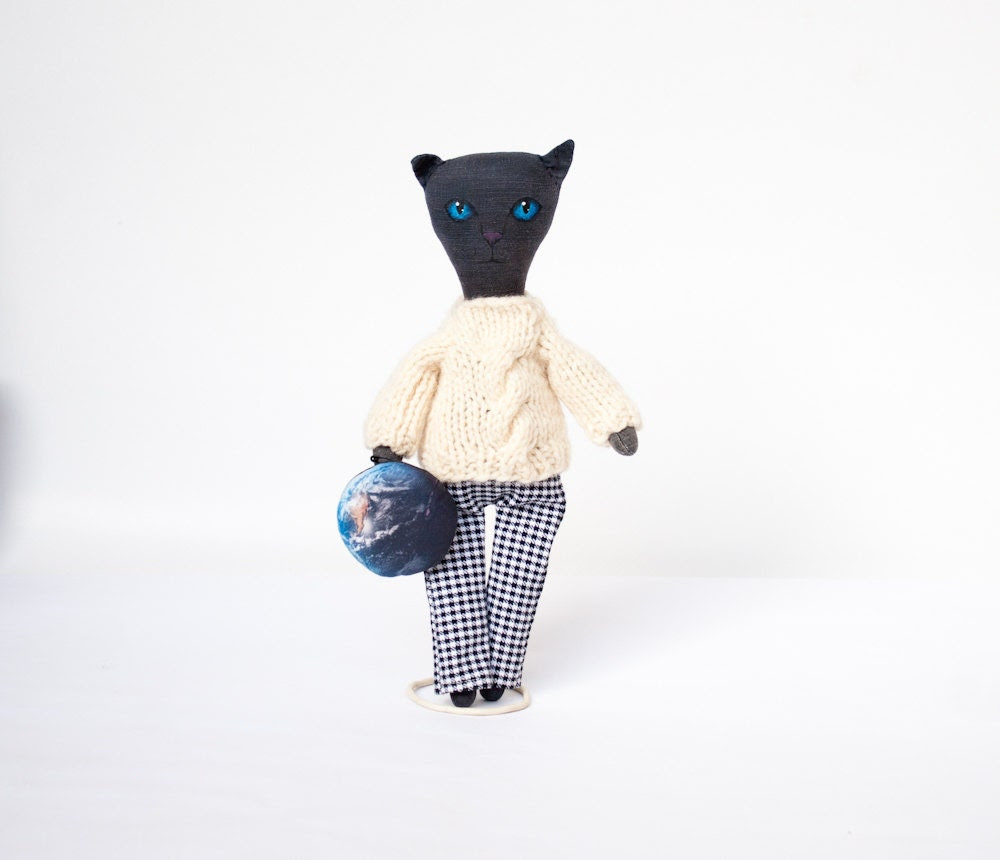 Black doll cat with Earth, primitive doll, cosmic cat with blue eyes