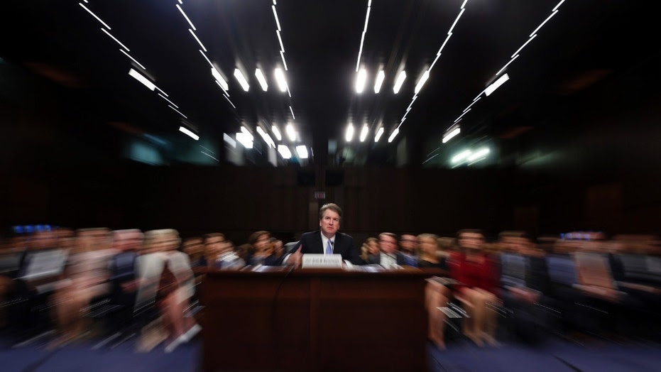 FILE - In this Thursday, Sept. 6, 2018 file photo made with a slow shutter speed and a zoom lens, President Donald Trump's Supreme Court nominee, Brett Kavanaugh testifies before the Senate Judiciary Committee on Capitol Hill in Washington, for the third day of his confirmation hearing.