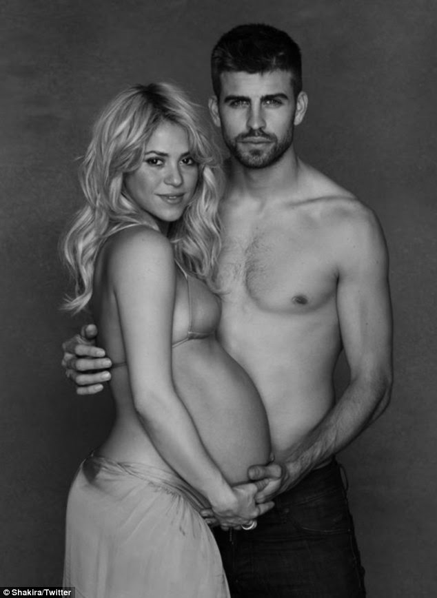 Pregnant and proud: Shakira and her footballer beau Gerad Pique have posed for this beautiful picture which shows the singer in all her pregnant glory
