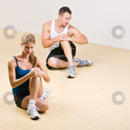 People stretching in health club stock photo, People stretching in