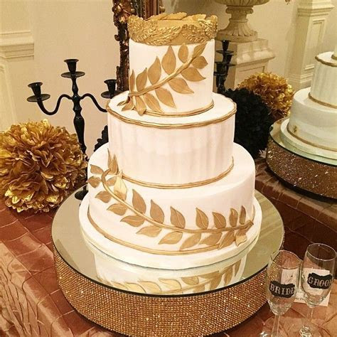 LaShaias' Grecian themed wedding cake  Accented in gold