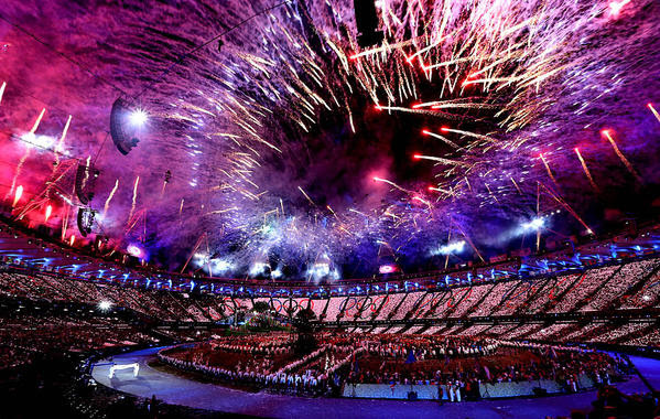 Fireworks ring the perimeter of Olympic Stadium.