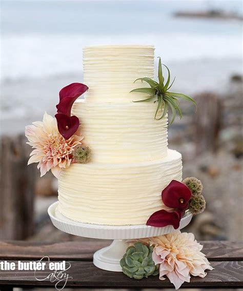 Horizontal buttercream stripe cake in Laguna Beach. By The