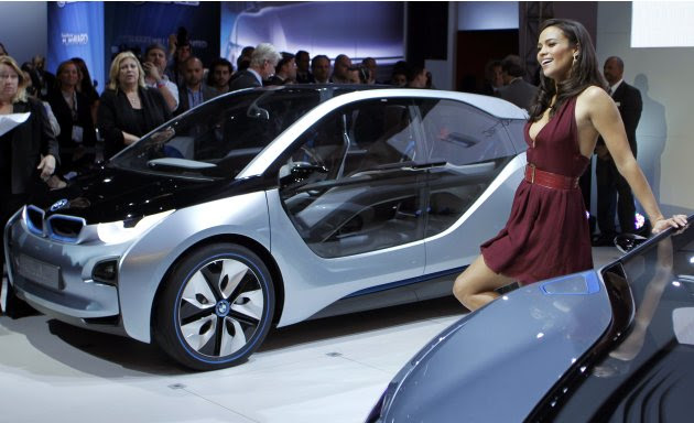 Actress Paula Patton poses as she participates in the North American debut of the BMW i3 and i8 at the LA Auto Show in Los Angeles