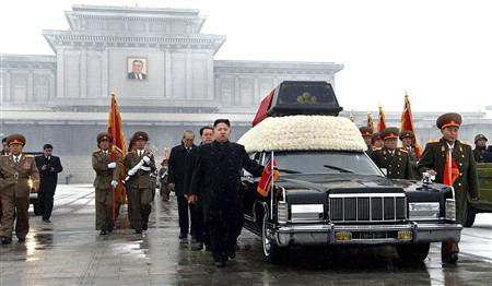 Vice-chairman of the Central Military Commission of the Workers' Party of North Korea Kim Jong-un (front C), his uncle Jang Song-thaek (behind Kim) and Chief of General Staff of the Korea People's Army Ri Yong-ho (R) with the coffin of Kim Jong Il. by Pan-African News Wire File Photos