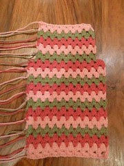 Crocheted hot water bottle cover