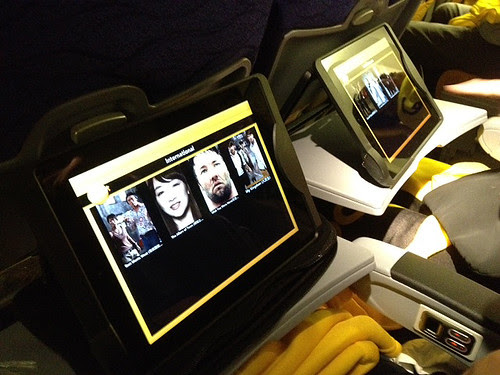 Tablets (iPads) loaded with movies, TV shows and games offer entertainment on the long flight