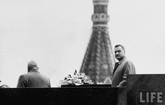 Gamal Abdul Nasser (R) and Soviet Nikita A. Khrushchev (L) atop building during parade celebration. May 1958ç
