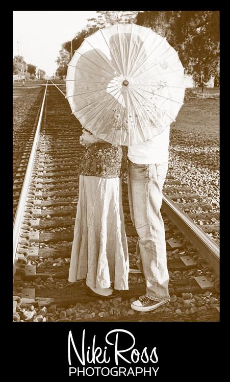 kissingtracks-behindumbrella