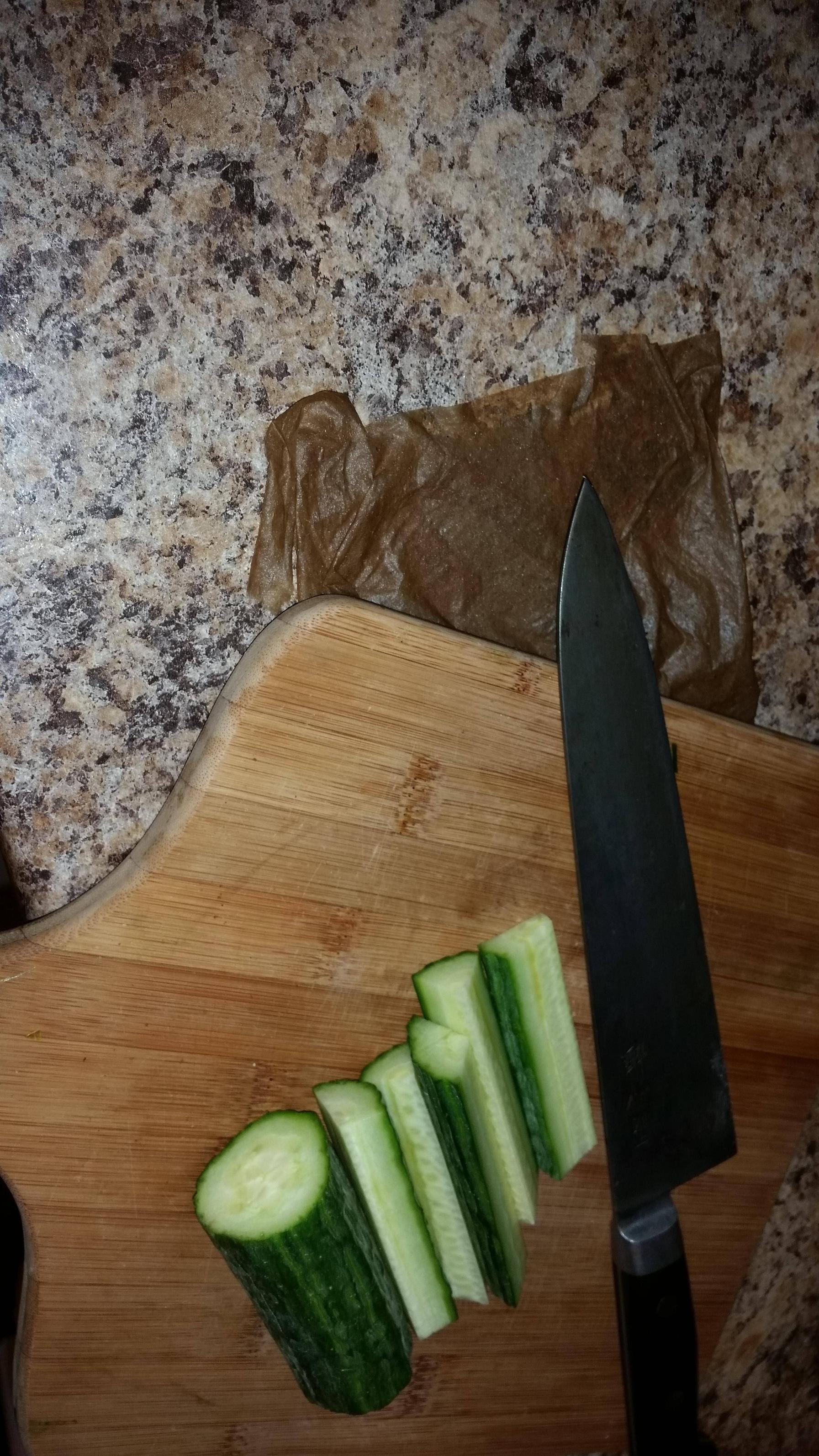 Put A Wet Paper Towel Under Your Cutting Board To Keep It From