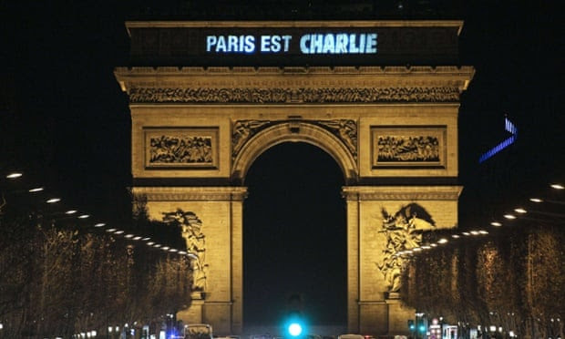 Paris is Charlie is projected onto the Arc de Triomphe in Paris, to pay tribute to the victims of a deadly attack on the headquarters of French satirical weekly Charlie Hebdo.