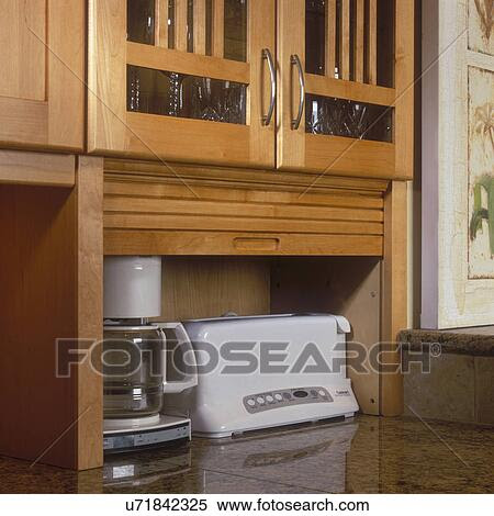 Stock Image of KITCHEN STORAGE DETAIL - Small Roll top ...