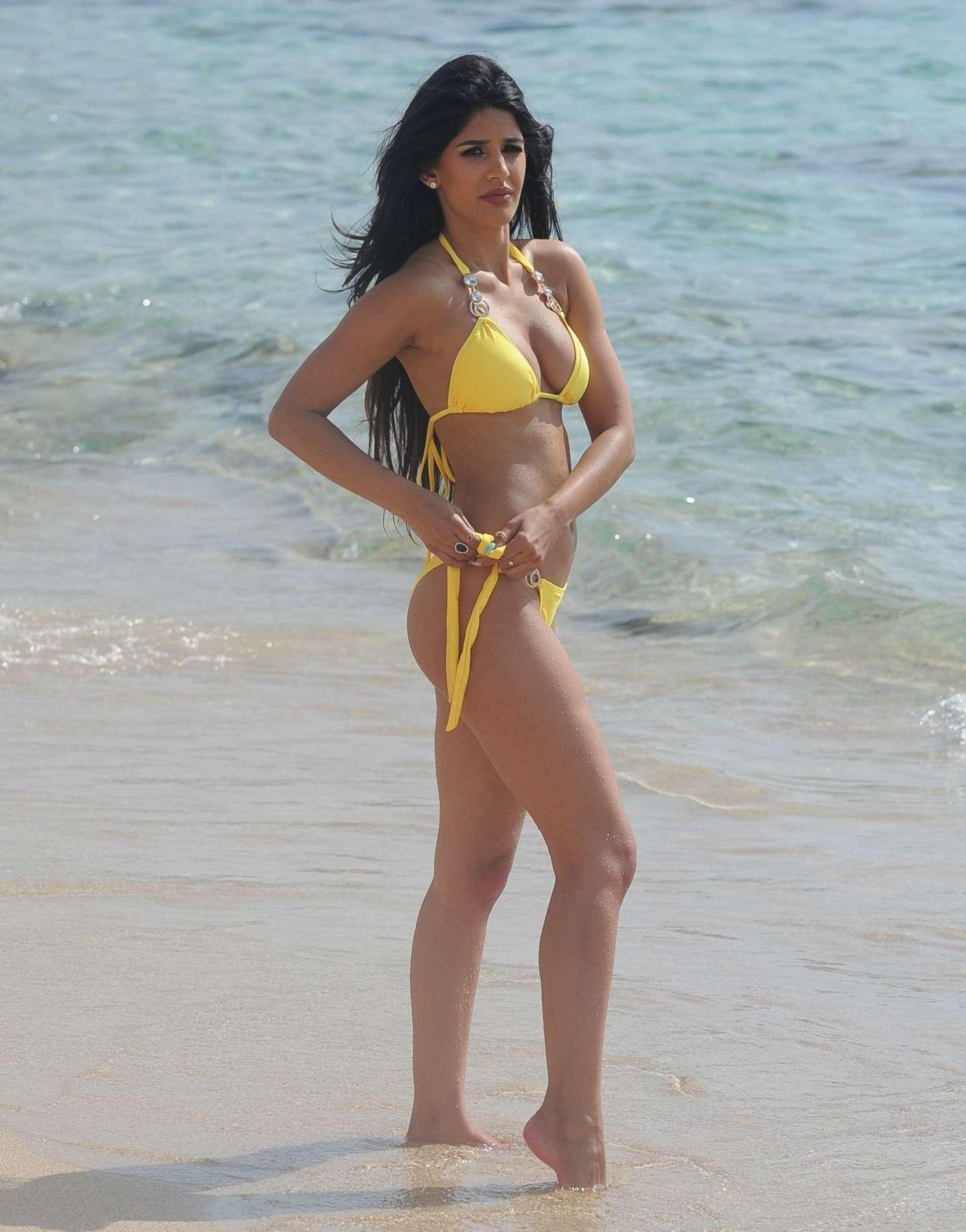 Jasmin Walia – Shows of hot bikini body in Yellow Bikini on Beach in Ibiza