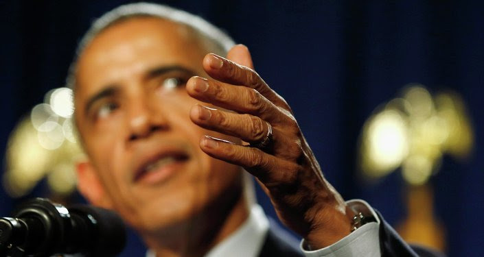 U.S. President Barack Obama makes a point with his hand as he delivers remarks at the House Democratic Issues Conference in Pennsylvania, January 29, 2015.