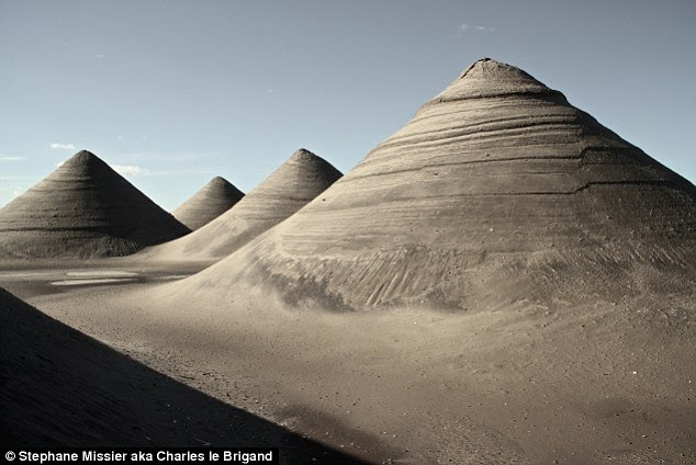 Like a lunar landscape the 30-feet tall dunes have been etched by the wind and were photographed on December 30th 2012