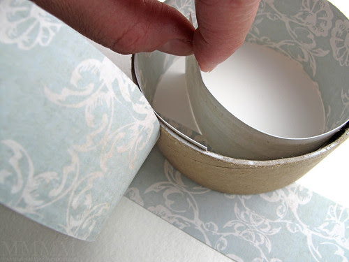 Step 14) Stick the final strip of patterned paper on the inside of the bottom ring