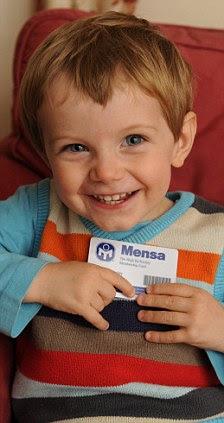 Oscar Wrigley clutches his prized Mensa membership card