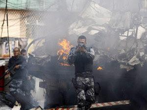 Oficial durante ação na Vila Cruzeiro