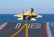 A carrier-borne J-15 fighter jet takes off from the Liaoning, China's first aircraft carrier, in this undated handout photo released November 25, 2012. China has successfully conducted flight landing on its first aircraft carrier, the Liaoning, after its delivery to the People's Liberation Army (PLA) Navy on September 25, 2012, according to Xinhua News Agency. REUTERS/Xinhua/Zha Chunming