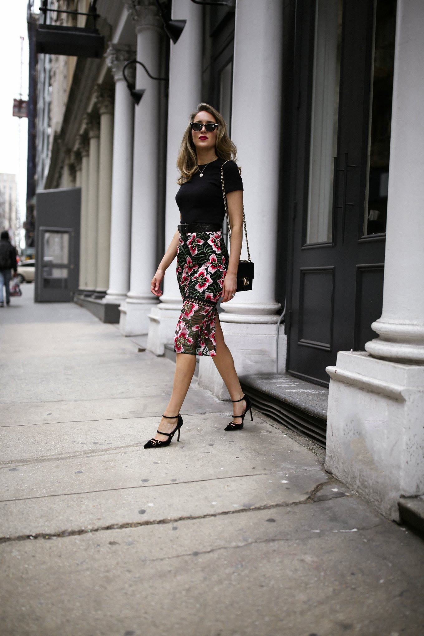 Mary orton wears a dark floral pencil skirt, black tee shirt, gucci wallet on chain, retro sunglasses and jimmy choo mary jane pumps