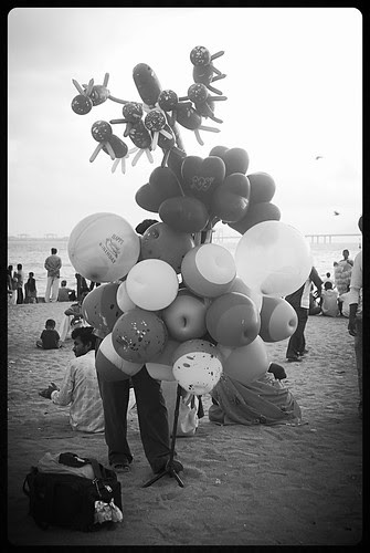 The Balloon Selling Bhaiyya At Juhu Beach by firoze shakir photographerno1
