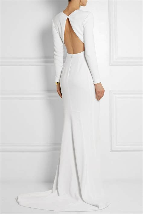 White stretch crepe Concealed hook and zip fastenings at