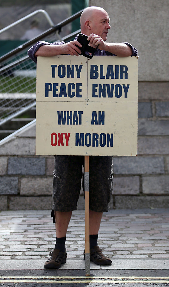 A protester outside the Queen Elizabeth II Conference Centre, London, where the publication of the Chilcot inquiry into the Iraq War is taking place. PRESS ASSOCIATION Photo. Picture date: Wednesday July 6, 2016. See PA story POLITICS Chilcot. Photo credit should read: Yui Mok/PA Wire
