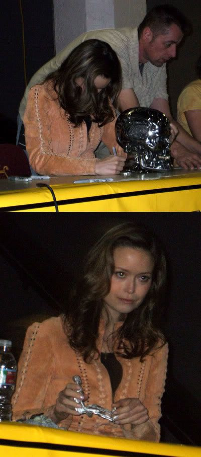 Summer Glau signing and playing with TERMINATOR memorabilia.