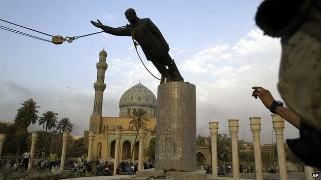 Statue of Saddam Hussein toppled in Baghdad. April 2003