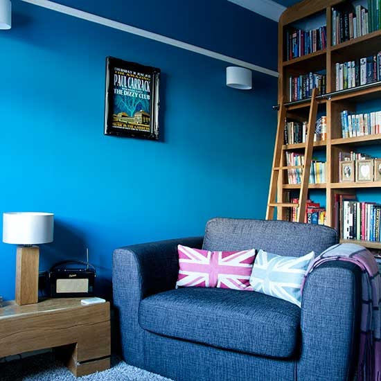 Library-style shelving in blue living room   Living room ...