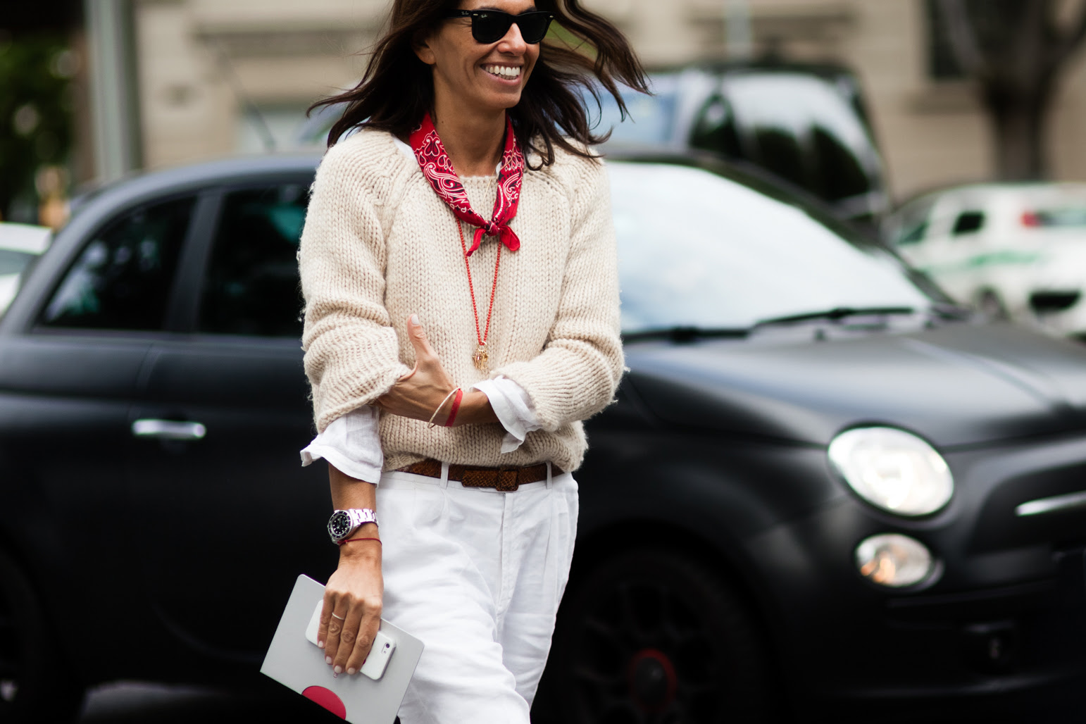 Viviana Volpicella wearing a white outfit and a red bandana scarf in Milan, Italy