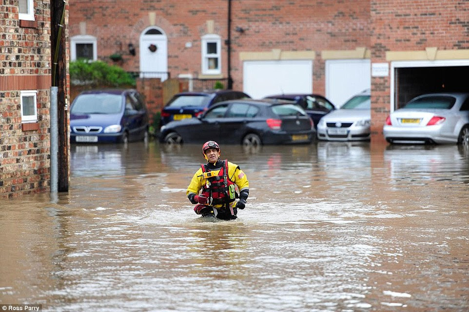 How it was: Huntington Road in York is pictured two days ago before the clean-up, after the city was submerged by the River Foss