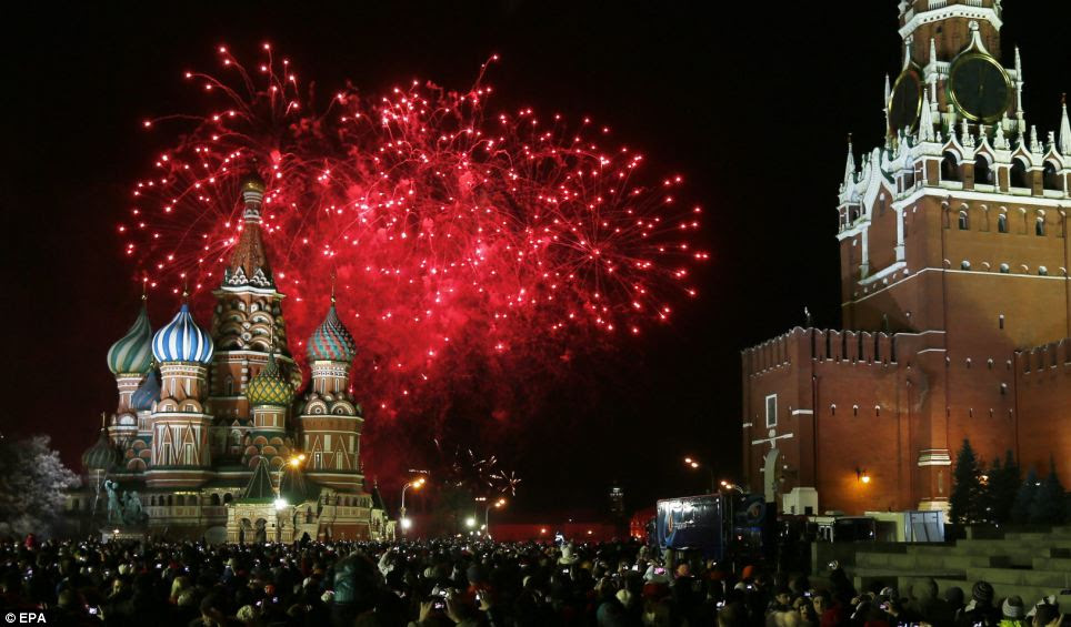 Revellers wrapped up and braved the cold as they watched spectacular displays explode across the Red Square