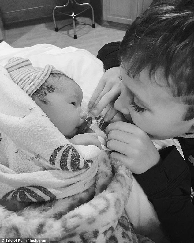 Special bond: The 25-year-old single mother-of-two also shared this snap of her seven-year-old son Tripp smiling down at his newborn sister