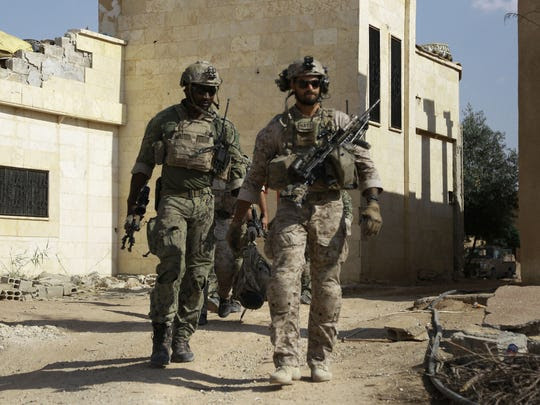 American commandos walk in the Syrian village of Fatisah,
