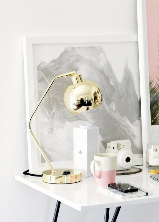 Le Fashion Blog Stylish Whimsical Work Space Urban Outfitters Gold Lamp Globe Metallic Lighting Pink Mug White Desk Office Decor