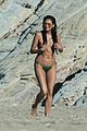 shay mitchell goes topless at the beach in greece 03