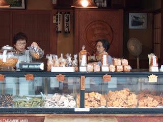 Women selling rice crackers, senbei in Japanese, in Kyoto