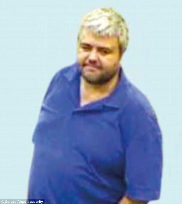 Master criminal: This airport surveillance camera image is the only photo to emerge allegedly showing Paul Calder Le Roux, the boss of a criminal empire spanning Hong Kong, the Phillipines, Brazil and Africa