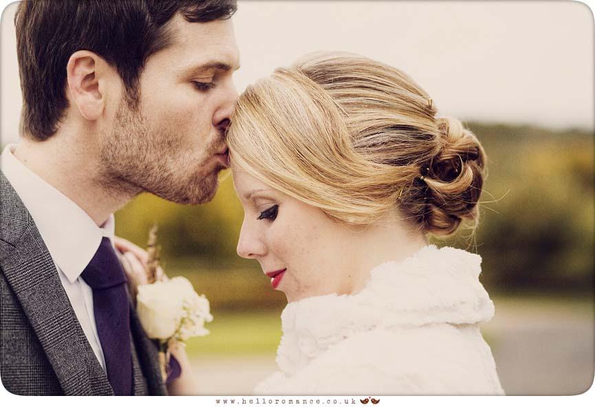 Groom kisses bride's head - Hello Romance