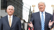 US President Donald Trump (R) speaks to the press with US Secretary of State Rex Tillerson (L) on August 11, 2017, at Trump National Golf Club in Bedminster, New Jersey.