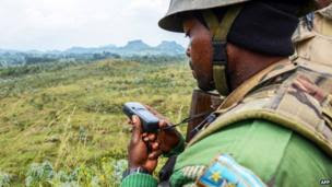 A Congolese army soldier looks at a GPS device on 15 June 2014 near Kanyesheza hill, near the border with Rwanda - 15 June 2014