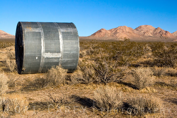 Water tank on its side at Cuddeback Dry Lake in the Mojave desert, California, USA