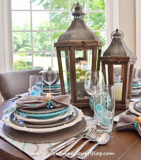Beautiful and casual turquoise and gray table setting on a round table