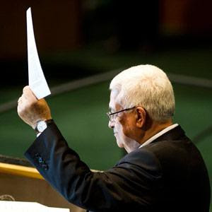 Palestinian President Mahmoud Abbas waving a copy of the letter delivered to the UN Security Council calling for state recognition for the people of this occupied nation in the Middle East. Abbas addressed the General Assembly on September 23, 2011. by Pan-African News Wire File Photos