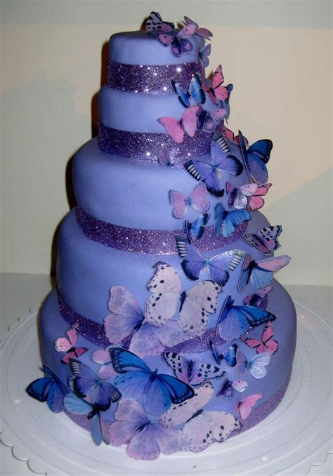 Purple butterfly cake but instead ivory icing and flowers